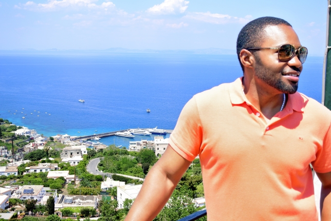 In Italy overlooking the island of Capri with Celebritiy music producer influencer Tyrone Smith wearing Marc Jacobs Louis Vuitton and LaPrairie