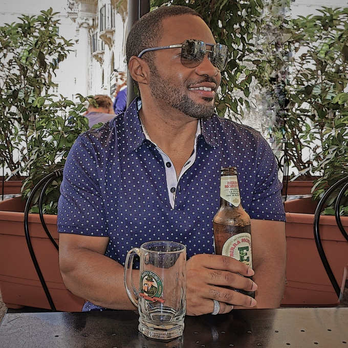 Celebrity musician producer social influencer Official Tyrone Smith in Palermo Sicily enjoying a Birra Moretti wearing Banana Republic, LaPrairie, Louis Vuitton